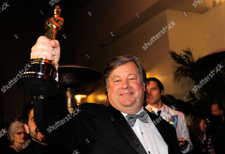 "Kirk Simon Kirk Simon holds up his oscar for best documentary short for ""Strangers NoMore"" at the Governors Ball following the 83rd Academy Awards, in the Hollywood section of Los Angeles"