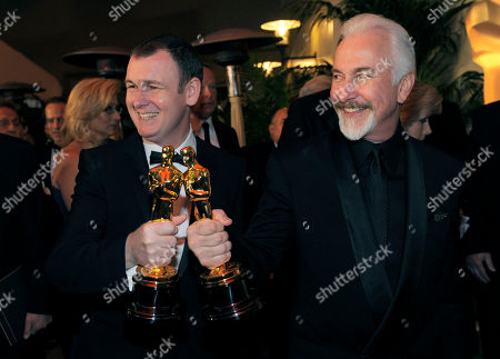 """Dave Elsey, Rick Baker Dave Elsey, left, and Rick Baker are seen with their academy awards for best makeup for """"The Wolfman"""" at the Governors Ball following the 83rd Academy Awards, in the Hollywood section of Los Angeles"""