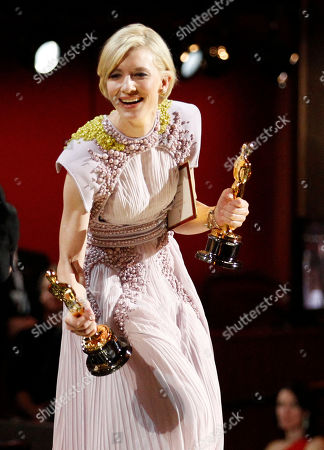 Cate Blanchett SCIENCES FOR USE UPON CONCLUSION OF THE ACADEMY AWARDS TELECAST ** Cate Blanchett presents Rick Baker and Dave Elsey with the Oscar for best makeup at the 83rd Academy Awards, in the Hollywood section of Los Angeles