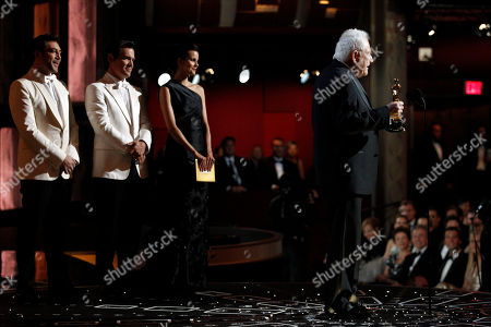 """David Seidler, Josh Brolin, Javier Bardem David Seidler accepts the Oscar for best original screenplay for his work in """"The King's Speech"""" as presenters Josh Brolin, second from left, and Javier Bardem watch during the 83rd Academy Awards, in the Hollywood section of Los Angeles"""