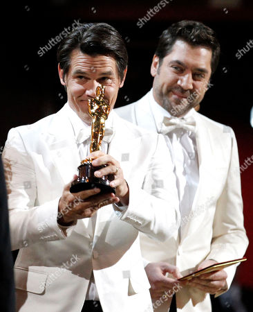 """Javier Bardem, Javier Bardem Actors Josh Brolin, left, and Javier Bardem present the Oscar for best original screenplay to David Seidler for """"The King's Speech"""" at the 83rd Academy Awards, in the Hollywood section of Los Angeles"""