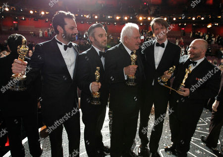 """Emile Sherman, Iain Canning, David Seidler, Tom Hooper, Gareth Unwin From left, Emile Sherman, Iain Canning, David Seidler, Tom Hooper and Gareth Unwin pose with the award for best picture for """"The King's Speech"""" at the 83rd Academy Awards, in the Hollywood section of Los Angeles"""