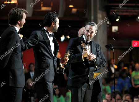 """Tom Hooper, Emile Sherman, Iain Canning Gareth Unwin From left,Tom Hooper, Emile Sherman, Iain Canning and Gareth Unwin accept the award for best picture for """"The King's Speech"""" at the 83rd Academy Awards, in the Hollywood section of Los Angeles"""