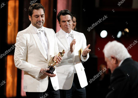 """Stock Picture of Javier Bardem, Josh Broslin, David Seidler Javier Bardem, left, and Josh Broslin present the Oscar for best original screenplay to David Seidler for """"The King's Speech"""" at the 83rd Academy Awards, in the Hollywood section of Los Angeles"""