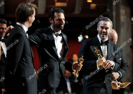 """Tom Hooper, Iain Canning, Emile Sherman From left, director Tom Hooper, and producers Iain Canning, and Emile Sherman accept the award for best picture for """"The King's Speech"""" at the 83rd Academy Awards, in the Hollywood section of Los Angeles"""