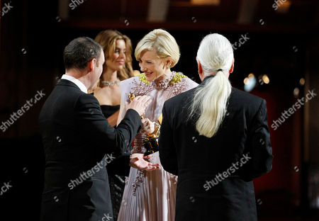 """Dave Elsey, Cate Blanchett, Rick Baker Cate Blanchett gives Rick Baker, right, and Dave Elsey, left, their Oscars for best makeup for """"The Wolfman"""" at the 83rd Academy Awards, in the Hollywood section of Los Angeles"""