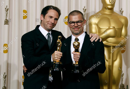 """Angus Wall, Kirk Baxter Angus Wall, right, and Kirk Baxter pose backstage with the Oscar for best film editing for """"The Social Network"""" at the 83rd Academy Awards, in the Hollywood section of Los Angeles"""