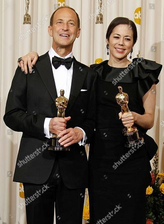 "Charles Ferguson, Audrey Marrs SCIENCES FOR USE UPON CONCLUSION OF THE ACADEMY AWARDS TELECAST ** Charles Ferguson and Audrey Marrs pose backstage with the Oscar for best documentary feature for ""Inside Job"" at the 83rd Academy Awards, in the Hollywood section of Los Angeles"