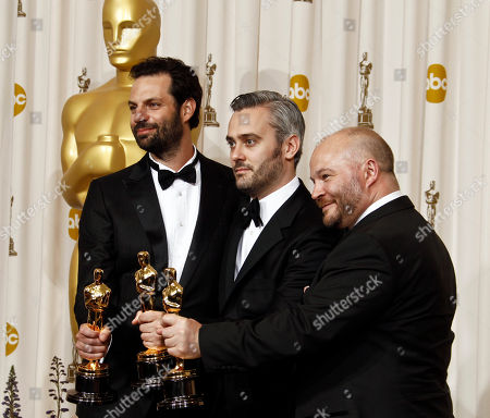 """Emile Sherman, left to right, Iain Canning and Gareth Unwin pose backstage with the Oscar for best motion picture for """"The King's Speech"""" at the 83rd Academy Awards, in the Hollywood section of Los Angeles"""