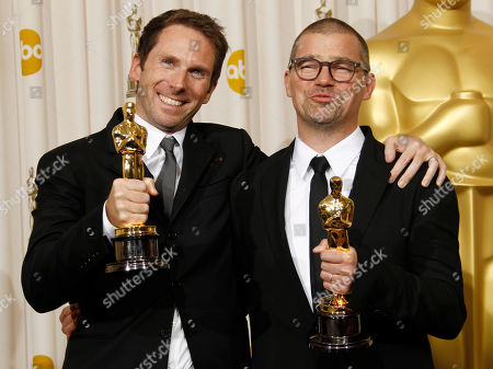 """Angus Wall, Kirk Baxter SCIENCES FOR USE UPON CONCLUSION OF THE ACADEMY AWARDS TELECAST **Angus Wall, right, and Kirk Baxter pose backstage with the Oscar for best film editing for """"The Social Network"""" at the 83rd Academy Awards, in the Hollywood section of Los Angeles"""