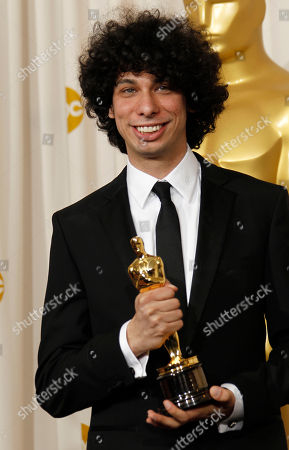 "Luke Matheny SCIENCES FOR USE UPON CONCLUSION OF THE ACADEMY AWARDS TELECAST **Luke Matheny poses backstage with the Oscar for best live action short film for ""God of Love"" at the 83rd Academy Awards, in the Hollywood section of Los Angeles"