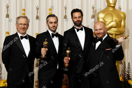 """Emile Sherman, left to right, Iain Canning and Gareth Unwin pose backstage with the Oscar for best motion picture for """"The King's Speech"""" at the 83rd Academy Awards, in the Hollywood section of Los Angeles. At left is Steven Spielberg"""