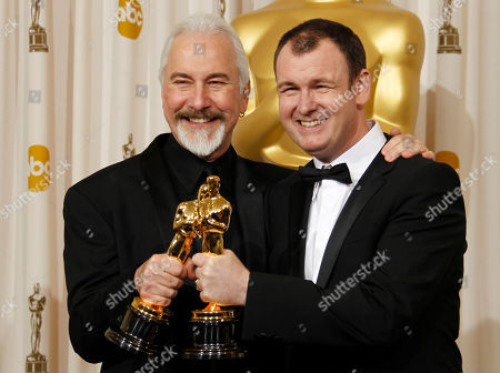 """Stock Picture of Rick Baker, Dave Elsey SCIENCES FOR USE UPON CONCLUSION OF THE ACADEMY AWARDS TELECAST **Rick Baker, left, and Dave Elsey pose backstage with the Oscar for best makeup for """"The Wolfman"""" at the 83rd Academy Awards, in the Hollywood section of Los Angeles"""