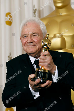 """David Seidler David Seidler poses backstage with the Oscar for best original screenplay for """"The King's Speech"""" at the 83rd Academy Awards, in the Hollywood section of Los Angeles"""