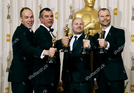 """Paul Franklin, Chris Corbould, Andrew Lockley, Peter Bebb Paul Franklin, left, Chris Corbould, second from left, Andrew Lockley, second from right, and Peter Bebb pose backstage with the Oscar for best visual effects for """"Inception"""" at the 83rd Academy Awards, in the Hollywood section of Los Angeles"""