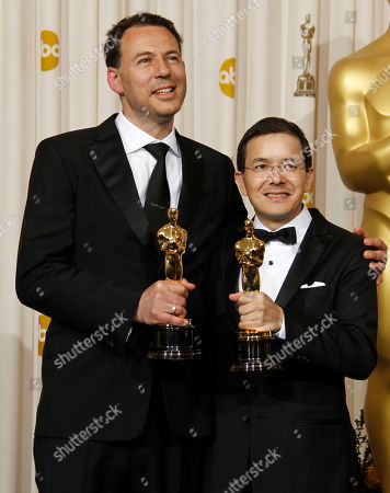 "Shaun Tan, Andrew Ruhemann SCIENCES FOR USE UPON CONCLUSION OF THE ACADEMY AWARDS TELECAST **Shaun Tan, right, and Andrew Ruhemann pose backstage with the Oscar for best animated short film for ""The Lost Thing"" at the 83rd Academy Awards, in the Hollywood section of Los Angeles"