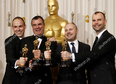 """Paul Franklin, Chris Corbould, Andrew Lockley, Peter Bebb SCIENCES FOR USE UPON CONCLUSION OF THE ACADEMY AWARDS TELECAST **Paul Franklin, left, Chris Corbould, second from left, Andrew Lockley, second from right, and Peter Bebb pose backstage with the Oscar for best visual effects for """"Inception"""" at the 83rd Academy Awards, in the Hollywood section of Los Angeles"""