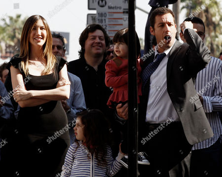 Adam Sandler, Sadie Sandler, Sunny Sandler, Jackie Sandler From right, Adam Sandler cheers as he is introduced while his daughters, Sunny and Sadie, and wife, Jackie, look, before he received a star on the Hollywood Walk of Fame in Los Angeles on