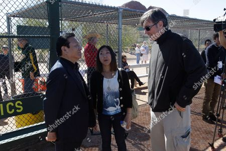 Billy Beane, Hideki Matsui, Masao Matsui Oakland Athletics General Manager Billy Beane talks to Hideki Matsui's father Masao Matsui on his first full squad workout at the team's spring training baseball facility in Phoenix