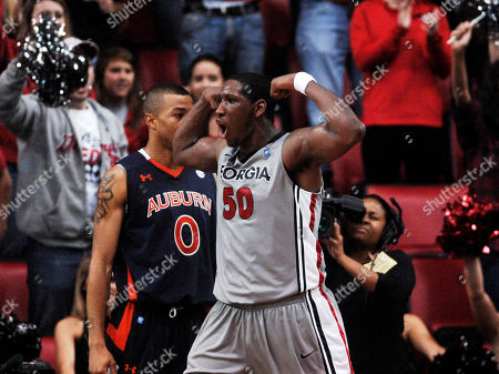 Stock Image of Georgia forward Jeremy Price (50) celebrates a dunk in front of Auburn's Josh Langford during the second half of an NCAA college basketball game at Stegeman Colisuem on in Athens, Ga. Georgia won 81-72 in overtime