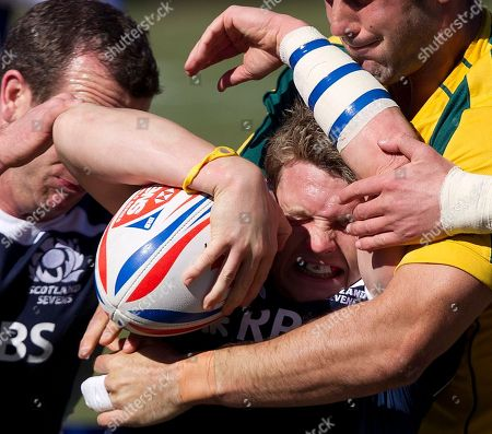 Ross Samson, Jonathon Lance Scotland's Ross Samson, center, gets tangled up with Australia's Jonathon Lance, right, during the first round of Stage 4 orf the Sevens World Series Rugby tournament, in Las Vegas