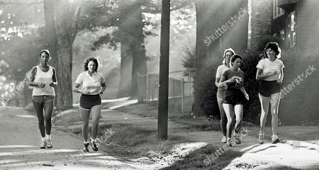 High school teacher Christa McAuliffe,second from left, jogs with friends in Concord, N.H. A whole generation _ including McAuliffe's own students _ has grown up since McAuliffe and six other astronauts perished on live TV on Jan. 28, 1986, a quarter century ago on . Now the former schoolchildren who loved her are making sure that people who weren't even born then know about McAuliffe and her dream of going into space