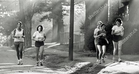 Stock Image of High school teacher Christa McAuliffe,second from left, jogs with friends in Concord, N.H. A whole generation _ including McAuliffe's own students _ has grown up since McAuliffe and six other astronauts perished on live TV on Jan. 28, 1986, a quarter century ago on . Now the former schoolchildren who loved her are making sure that people who weren't even born then know about McAuliffe and her dream of going into space
