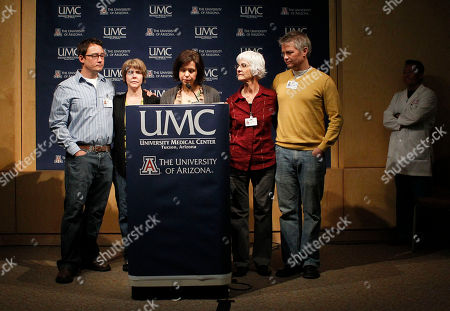 Peter Rhee, Jenny Douglas, Nancy Barber, Crissi Blake, Jason Blake, Gawain Douglas Jenny Douglas, daughter of Ronald Barber, an aide to Rep. Gabrielle Giffords, D-Ariz., that was injured in the assassination attempt on the third-term Democrat, speaks the podium during a morning medical briefing at University Medical Center, in Tucson, Ariz. She is joined by family members including her mother Nancy Barber, second from right, Jason Blake, left, Crissi Blake, second left, and Gawain Douglas, right, as Dr. Peter Rhee, Director of Trauma Critical Care Emergency Surgery, stands at the far right