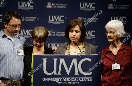 Jenny Douglas, Nancy Barber, Crissi Blake, Jason Blake Jenny Douglas speaks at the podium as she is joined by family members, including her mother Nancy Barber, right, Jason Blake, left, and Crissi Blake, to talk about the condtition of her father, Ronald Barber, during the morning medical briefing at University Medical Center, in Tucson, Ariz. Ronald Barber was one of 19 victims shot on Saturday, including Rep. Gabrielle Giffords, D-Ariz., who is still in critical condition