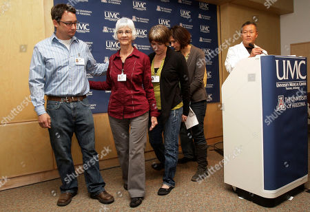 Peter Rhee, Jenny Douglas, Nancy Barber, Crissi Blake, Jason Blake, Gawain Douglas Family members of Ronald Barber, an aide to Rep. Gabrielle Giffords, D-Ariz., that was injured in the assassination attempt on the third-term Democrat, leave the podium during a morning medical briefing at University Medical Center, in Tucson, Ariz. From left to right are Jason Blake, Nancy Barber, Crissi Blake, Jenny Douglas, and Gawain Douglas. Dr. Peter Rhee, Director of Trauma Critical Care Emergency Surgery stands at the podium updating the conditions of Giffords, who is still in critical condition