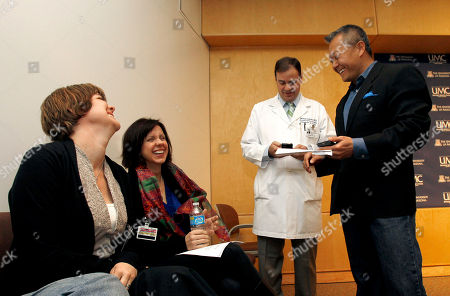 Peter Rhee, Jenny Douglas, Crissi Blake, Michael Lemole Daughters of gunshot injury patient Ronald Barber, who is the district director to Rep. Gabrielle Giffords, D-Ariz., Crissi Blake, left, and Jenny Douglas, second from left, share a lighter moment with Dr. Peter Rhee, right, Director of Trauma Critical Care Emergency Surgery, and Dr. Michael Lemole, Chief of Neurosurgery, before it was announced that Barber had been released from the hospital at a morning medical briefing at University Medical Center, in Tucson, Ariz. Giffords, who is still in critical condition, was one of 19 victims shot on Saturday, six fatally