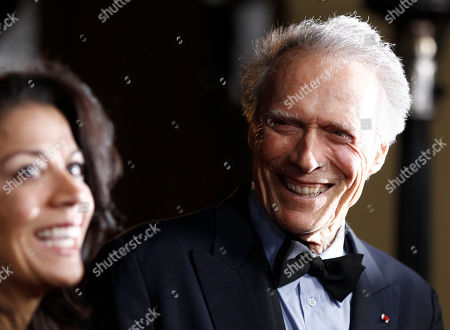 Clint Eastwood, Dina Eastwood Clint Eastwood, right, and Dina Eastwood arrive at the 63rd annual DGA Awards, in Los Angeles