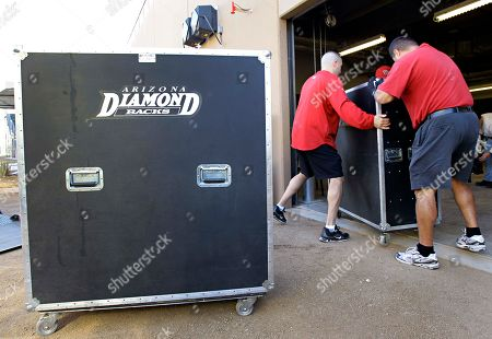 Jimmy Garrett, Shawn Moore Arizona Diamondbacks assistant equipment managers Jimmy Garrett and Shawn Moore, right, unload a moving truck with team equipment, at the team's new spring training facility in Scottsdale, Ariz. The Diamondbacks are preparing for their first spring training season in Scottsdale; the team's former facility was in Tucson