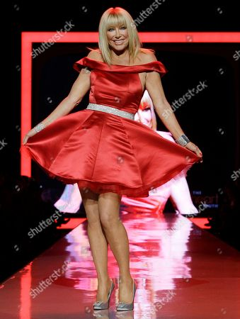 Suzanne Somers Suzanne Somers walks the runway wearing a dress designed by Ina Soltani during the Heart Truth Red Dress Fall 2011 show in New York