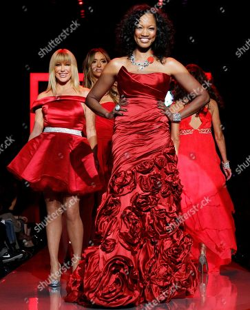Garcelle Beauvais, Suzanne Somers Garcelle Beauvais, center, walks the runway wearing a dress designed by Monique Lhuiller with Suzanne Somers, left, in Ina Soltani behind her during the Heart Truth Red Dress Fall 2011 show in New York