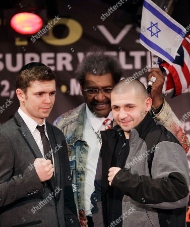 Yuri Foreman, left, of Brooklyn, N.Y., and Pawel Wolak, of Mount Arlington, N.J., pose for photographers during a boxing news conference, in New York. The two are scheduled to face off in a super welterweight bout on March 12, 2011, in Las Vegas. Behind them is promoter Don King
