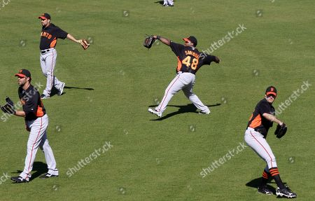 Casey Dagle, Andres Torres, Pablo Sandoval, Barry Zito San Francisco Giants players including, Casey Daigle, bottom left, Andres Torres, top left, Pablo Sandoval (48) and Barry Zito, bottom right, warm up at the team's spring training baseball facility in Scottsdale, Ariz
