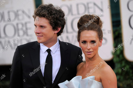 Jennifer Love Hewitt, right, is joined by boyfriend Alex Beh before the Golden Globe Awards, in Beverly Hills, Calif