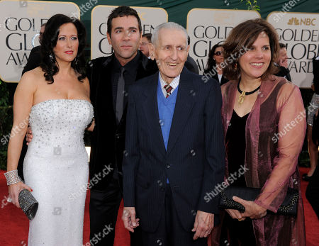 Dr. Jack Kevorkian, center, poses on the red carpet before the Golden Globe Awards, in Beverly Hills, Calif