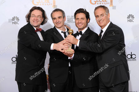 "Jens Maurer, Olivier Assayas, Edgar Ramirez, Daniel Leconte From left, producer Jens Maurer, writer and director Olivier Assayas, actor Edgar Ramirez, and producer Daniel Leconte hold up their award for Best mini-Series or Motion Picture Made for Television for ""Carlos"" at the Golden Globe Awards, in Beverly Hills, Calif"