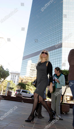 Lady Catarina Pietra Toumei Lady Catarina Pietra Toumei, left, arrives at the federal courthouse in San Diego, . Toumei, an alleged countess, has been charged in New york for wire fraud