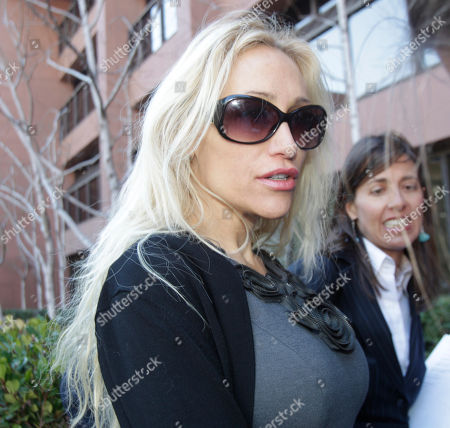 Stock Picture of Lady Catarina Pietra Toumei, Gretchen Von Helms Lady Catarina Pietra Toumei, left, and her attorney, Gretchen Von Helms, arrive at the federal courthouse in San Diego, . Toumei, an alleged countess, has been charged in New York for wire fraud