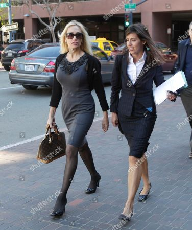 Stock Photo of Lady Catarina Pietra Toumei, Gretchen Von Helms Lady Catarina Pietra Toumei, left, and her attorney, Gretchen Von Helms, arrive at the federal courthouse in San Diego, . Toumei, an alleged countess, has been charged in New York for wire fraud