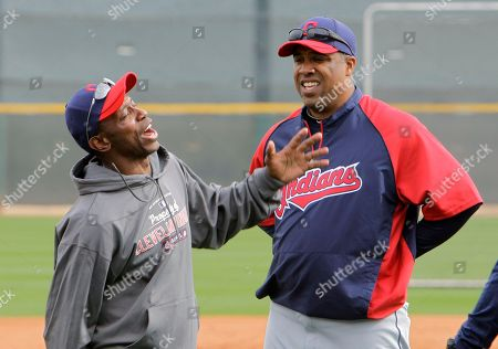 Kenny Lofton, Eduardo Perez Former Cleveland Indians outfielder Kenny Lofton jokes with coach Eduardo Perez baseball spring training, in Goodyear, Ariz
