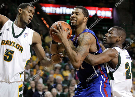 Markieff Morris, LaceDarius Dunn, Perry Jones Kansas forward Markieff Morris, center, grabs a rebound in front of Baylor's Perry Jones (5) and LaceDarius Dunn, right, in the second half of an NCAA college basketball game, in Waco, Texas. Morris had 19 points and nine rebounds in the 85-65 Kansas win