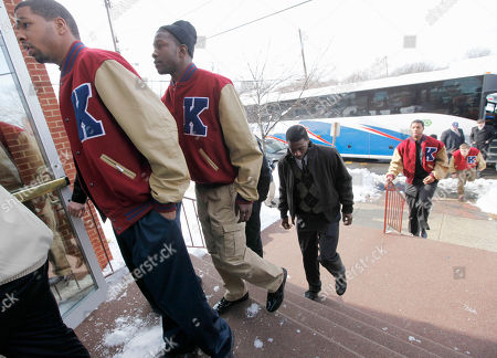 Members of the Kansas basketball team arrive to attend the funeral services of Lisa Robinson, mother of teammate Thomas Robinson, at Antioch Baptist Church in Washington