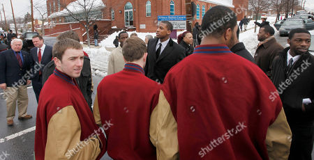 Thomas Robinson Kansas basketball player Thomas Robinson, center, meets with his teammates and friends following funeral services for his mother, Lisa Robinson, at Antioch Baptist Church in Washington