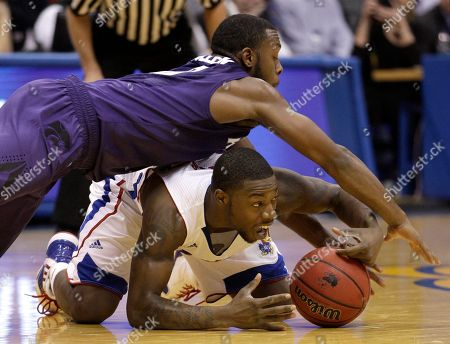 Elijah Johnson Kansas State guard Jacob Pullen, top, and Kansas guard Elijah Johnson, bottom, chase a loose ball during the first half of an NCAA college basketball game in Lawrence, Kan