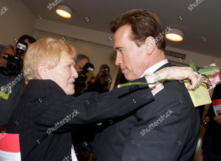 Elaine LaLanne, widow of Jack LaLanne, left, embraces former California governor and body builder Arnold Schwarzenegger at a memorial service for her fitness guru husband in Los Angeles . LaLanne died Jan. 23 at the age of 96