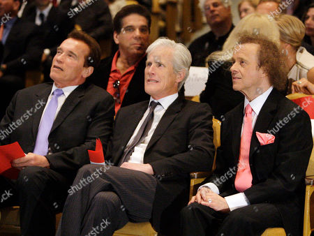 Former California Gov. Arnold Schwarzenegger, left, actor Lou Ferrigno, back row left, broadcaster Keith Morrison and fitness expert Richard Simmons, right, attend a memorial service for fitness guru Jack LaLanne, in Los Angeles . LaLanne died Jan. 23 at the age of 96